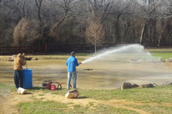 Spraying Alum on a pond